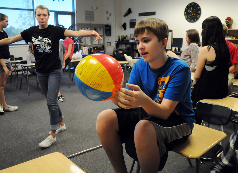 Joe Connors reads a question written on a beach ball during Broomfield High School's freshman transition day on Tuesday.<br /> August 17, 2010<br /> staff photo/David R. Jennings
