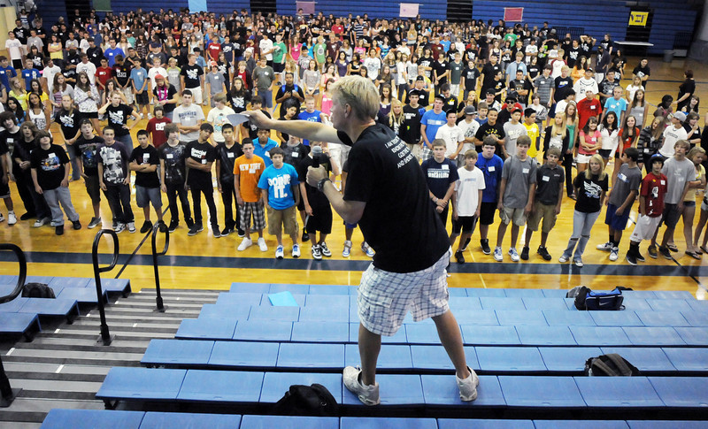 Broomfield High School teacher Greg Garner leads the freshman class of over 400 students in an team building exercise during Tuesday's freshman transition day.<br /> August 17, 2010<br /> staff photo/David R. Jennings
