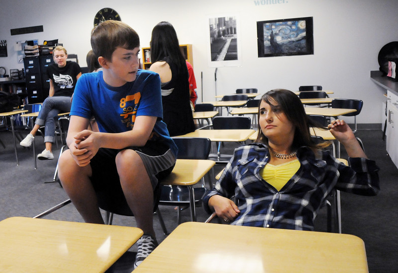 Joe Connors left, chats with classmate Marie Arvinte during a Broomfield High School Blue Crew leadership activity for  Tuesday's freshman transition day.<br /> August 17, 2010<br /> staff photo/David R. Jennings