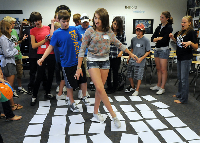 Jaden Ahrens, center, leads her fellow freshman through a rocks-turtles puzzle during Broomfield High School's Blue Crew  freshman transition day on Tuesday.<br /> August 17, 2010<br /> staff photo/David R. Jennings
