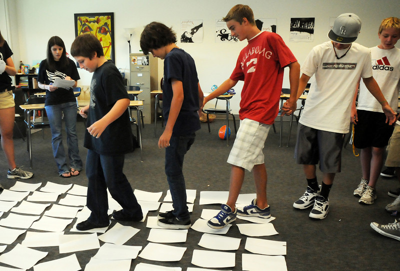 Jonny Schmitt, left, leads his fellow freshman through a rocks-turtles puzzle during Broomfield High School's Blue Crew  freshman transition day on Tuesday.<br /> August 17, 2010<br /> staff photo/David R. Jennings