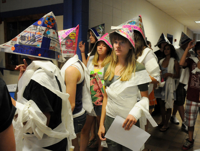 Broomfield High School freshman Lauren Nalezny, center, with her freshman group dressed as mummies wearing hats, follow their  Blue Crew leader on a tour of the school during Tuesday's freshman transition day.<br /> August 17, 2010<br /> staff photo/David R. Jennings