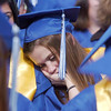 The 7:30 a.m. commencement catches up to Sara Cade during Saturday's Broomfield High School graduation ceremony at Elizabeth Kennedy Stadium.  The first person in line for the ceremony was at the gates at 4:45 a.m.<br /> May 21, 2011<br /> staff photo/David R. Jennings