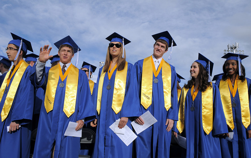 Honor Society members stand during Saturday's Broomfield High School graduation ceremony at Elizabeth Kennedy Stadium.<br /> May 21, 2011<br /> staff photo/David R. Jennings