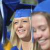 Bre Burgesser smiles while listening to classmates give their speeches during Saturday's Broomfield High School graduation ceremony at Elizabeth Kennedy Stadium.<br /> May 21, 2011<br /> staff photo/David R. Jennings
