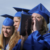 Jessica Eatmon, right, cheers for a classmate while Madison Goering, left, and Kayla Baher watch during the presentation of diplomas at Saturday's Broomfield High School graduation ceremony at Elizabeth Kennedy Stadium.<br /> May 21, 2011<br /> staff photo/David R. Jennings