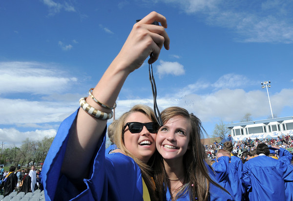 Kristen Leenerman, left, takes a picture of herself and Kaley Platek after Saturday's Broomfield High School graduation ceremony at Elizabeth Kennedy Stadium.<br /> May 21, 2011<br /> staff photo/David R. Jennings
