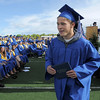 Trent Ireland hurries off the stage after receiving his diploma to go to the state track meet to run in the 100 yard dash during Saturday's Broomfield High School graduation ceremony at Elizabeth Kennedy Stadium.<br /> May 21, 2011<br /> staff photo/David R. Jennings