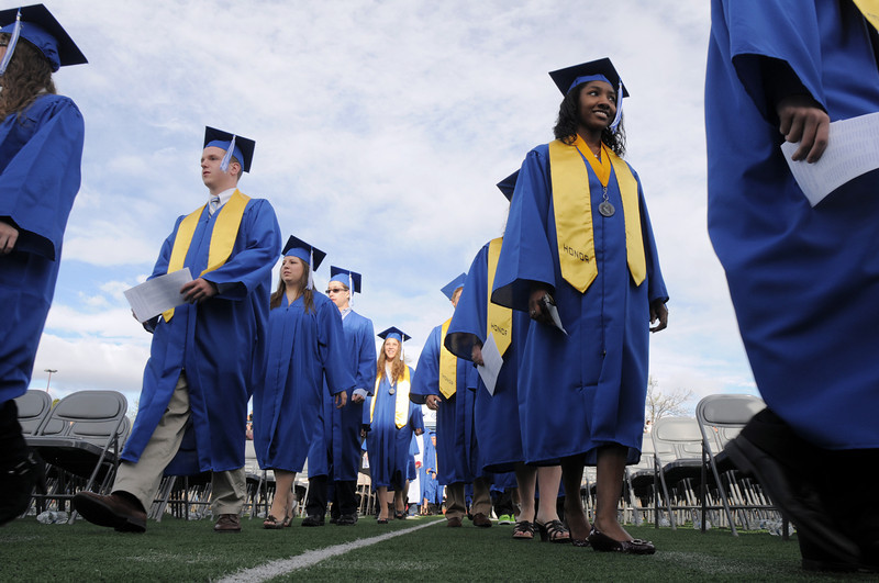 Broomfield High School's class of 2011 marches in for the graduation ceremony at Elizabeth Kennedy Stadium on Saturday.<br /> May 21, 2011<br /> staff photo/David R. Jennings