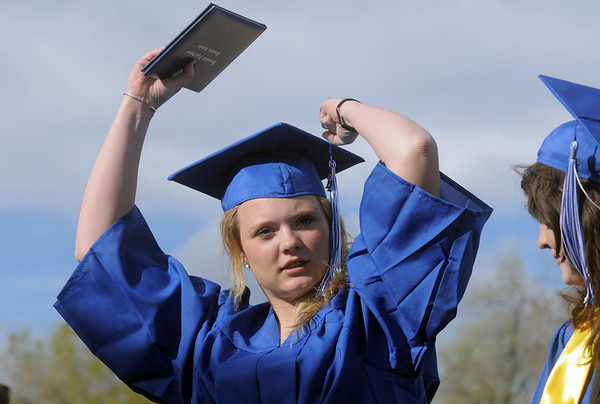 Jessica Eatmon gives a cheer for a classmate during Saturday's Broomfield High School graduation ceremony at Elizabeth Kennedy Stadium.<br /> May 21, 2011<br /> staff photo/David R. Jennings