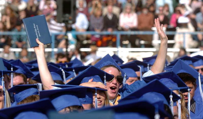 Matt Gleason gives a cheer for a fellow classmate during Saturday's Broomfield High School graduation ceremony at Elizabeth Kennedy Stadium.<br /> May 21, 2011<br /> staff photo/David R. Jennings