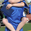 Ashley Weigel hugs Roman Lepard after  Saturday's Broomfield High School graduation ceremony at Elizabeth Kennedy Stadium.<br /> May 21, 2011<br /> staff photo/David R. Jennings