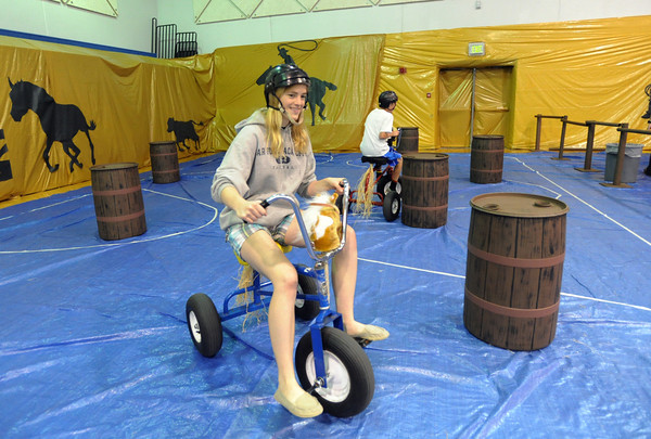 Katie Eaman, 14, rides a giant tricycle through the barrel racing course during the public tour of Broomfield High's JAM,  Just After Midnight , at the school on Saturday. <br /> April 28, 2012 <br /> staff photo/ David R. Jennings