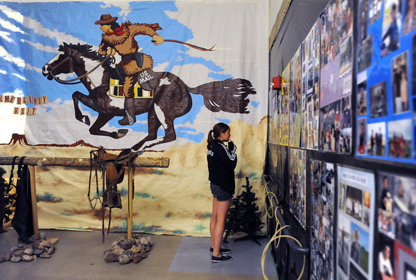 Bailey Estes, 14, looks at senior posters in the Pony Express hallway during the public tour of Broomfield High's JAM,  Just After Midnight , at the school on Saturday. <br /> <br /> April 28, 2012 <br /> staff photo/ David R. Jennings