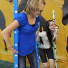 Emilee Schwartz, 12, left, Camille Laufasa-Duncan, 13, try walking on stilts during the public tour of Broomfield High's JAM,  Just After Midnight , at the school on Saturday. <br /> <br /> April 28, 2012 <br /> staff photo/ David R. Jennings