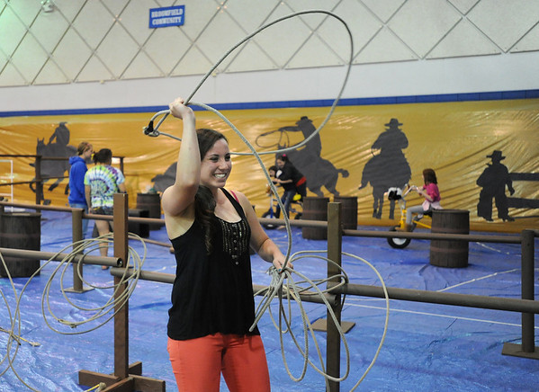Kelsey Jones, 16, twirls a lasso  in the calf roping area during the public tour of Broomfield High's JAM,  Just After Midnight , at the school on Saturday. <br /> <br /> April 28, 2012 <br /> staff photo/ David R. Jennings
