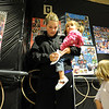 Krista Fredericks with her daughters Michaela, 2, and Maiyah, 4, writes a note to her brother Kory Skattum in the senior posters hall during the public tour of Broomfield High's JAM,  Just After Midnight , at the school on Saturday. <br /> <br /> April 28, 2012 <br /> staff photo/ David R. Jennings