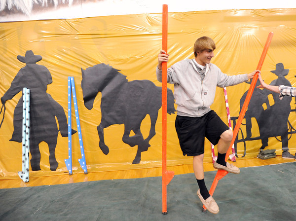 Mike Rosencrans, 16, attempts to use stilts during the public tour of Broomfield High's JAM,  Just After Midnight , at the school on Saturday. <br /> <br /> April 28, 2012 <br /> staff photo/ David R. Jennings