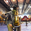 Katie Eaman, 14, rides a giant tricycle through the barrel racing course during the public tour of Broomfield High's JAM,  Just After Midnight , at the school on Saturday. <br /> <br /> April 28, 2012 <br /> staff photo/ David R. Jennings