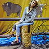 Joelle File poses for pictures while sitting in a giant boot during the public tour of Broomfield High's JAM,  Just After Midnight , at the school on Saturday. <br /> <br /> April 28, 2012 <br /> staff photo/ David R. Jennings