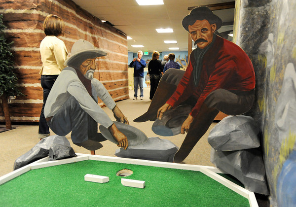 Paintings of miners for the putt-putt golf course while visitors take pictures during the public tour of Broomfield High's JAM,  Just After Midnight , at the school on Saturday. <br /> <br /> April 28, 2012 <br /> staff photo/ David R. Jennings