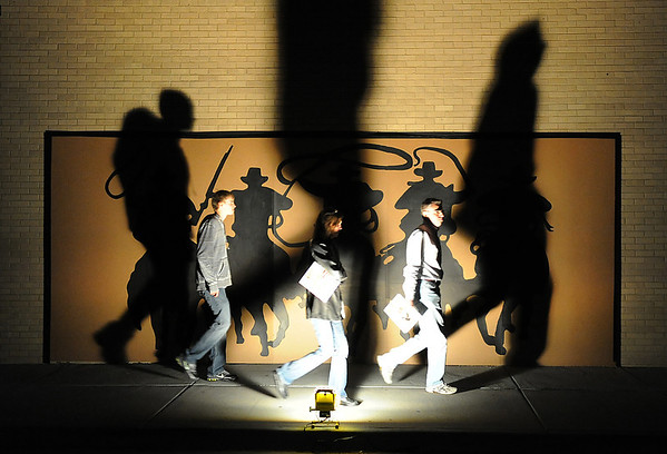 Visitors walk past the outdoor mural during the public tour of Broomfield High's JAM,  Just After Midnight , at the school on Saturday. <br /> <br /> April 28, 2012 <br /> staff photo/ David R. Jennings