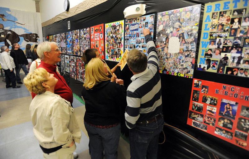 Friends and family look at the senior posters during the public tour of Broomfield High's JAM,  Just After Midnight , at the school on Saturday. <br /> <br /> April 28, 2012 <br /> staff photo/ David R. Jennings