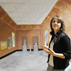 "Maren Philip, 15, and Bridget Admire, 15, are taken in by the perspective painting of the Louvre Museum by Kan Delgado as they tour the Just After Midnight open house at Broomfield High School on Saturday. They said ""it's like falling into the painting.""<br /> <br /> <br /> April 24, 2010<br /> Staff photo/ David R. Jennings"