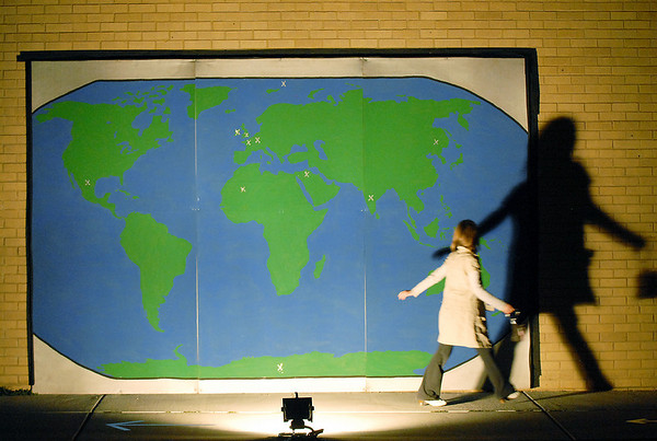 A girl looks at her shadow case against the world map on the outside of the high school during the Just After Midnight open house  at Broomfield High School on Saturday. <br /> <br /> April 24, 2010<br /> Staff photo/ David R. Jennings