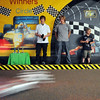 Justin Berndt, 19, left, Kyle Blas, 19 and Spencer Blas, 9, demonstrate model car racing in the Monte Carlo room during the Just After Midnight open house  at Broomfield High School on Saturday. <br /> <br /> April 24, 2010<br /> Staff photo/ David R. Jennings