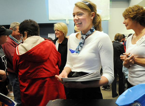 Kathryn Middel-Katzenmeyer, a sophomore, greets people dressed as a stewardess during the Just After Midnight open house  at Broomfield High School on Saturday. <br /> <br /> April 24, 2010<br /> Staff photo/ David R. Jennings