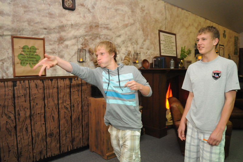 Thomas O'Brien, 14, left, and Blake Seitz, 14, test their skill at throwing darts in the Irish Pub room during the Just After Midnight open house  at Broomfield High School on Saturday. <br /> <br /> April 24, 2010<br /> Staff photo/ David R. Jennings
