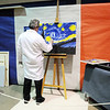 Artist Ken Delgado makes a painting in the French room during the Just After Midnight open house  at Broomfield High School on Saturday. <br /> <br /> April 24, 2010<br /> Staff photo/ David R. Jennings