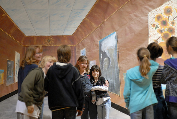 People pose for picture in front of the Louvre Museum perspective painting during the Just After Midnight open house  at Broomfield High School on Saturday. <br /> <br /> April 24, 2010<br /> Staff photo/ David R. Jennings