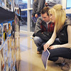 Alumni Andrew Pannes, left, and Amanda Kafer look at Panes's sister's senior poster during the Just After Midnight open house  at Broomfield High School on Saturday. <br /> <br /> April 24, 2010<br /> Staff photo/ David R. Jennings