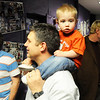 Eric Decker holds his son, Lucas, 14 months-old, on his soulders while looking at senior posters during the Just After Midnight open house  at Broomfield High School on Saturday. <br /> <br /> April 24, 2010<br /> Staff photo/ David R. Jennings