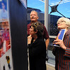 Joyce Near, right, looks at her grandson, Matt Persa, senior poster during the Just After Midnight open house  at Broomfield High School on Saturday. <br /> <br /> April 24, 2010<br /> Staff photo/ David R. Jennings