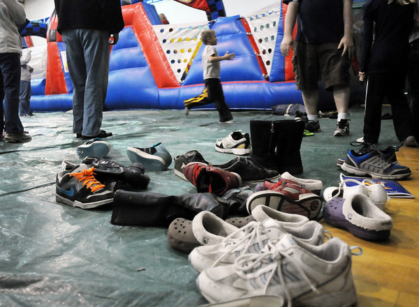 Shoes on the floor as their owners try their skills at the inflatable maze during the Just After Midnight open house  at Broomfield High School on Saturday. <br /> <br /> April 24, 2010<br /> Staff photo/ David R. Jennings