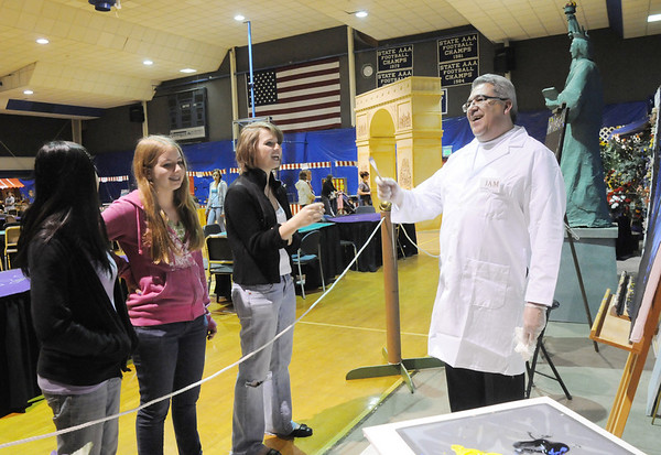 Molly Ditges, 15, left, Bridget Admire, 15, and Maren Philip, 15, talk to artist Ken Delgado during the Just After Midnight open house  at Broomfield High School on Saturday.  Delgado was making paintings for sale and painted some of the murals in various rooms.<br /> <br /> April 24, 2010<br /> Staff photo/ David R. Jennings