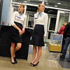 Sophomores Kathryn Middel-Katzenmeyer, left, and Kate Summerfield take a break at the stewardesses greeting people touring the Just After Midnight open house at Broomfield High School on Saturday. <br /> <br /> April 24, 2010<br /> Staff photo/ David R. Jennings