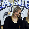 Broomfield High's Bailey Gabel signs her letter of intent to xxx on national signing day in the Eagle Gym on Wednesday.<br /> February 3, 2010<br /> Staff photo/David R. Jennings
