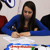 Broomfield High's Caitlin Updike signs her letter of intent to Louisiana Tech University on national signing day in the Eagle Gym on Wednesday.<br /> February 3, 2010<br /> Staff photo/David R. Jennings