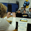 Jodee Seitz, left, takes a picture of her son Garrett with his friends and relatives during Broomfield High national signing day in the Eagle Gym on Wednesday.<br /> February 3, 2010<br /> Staff photo/David R. Jennings
