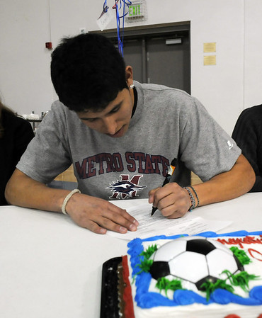 Broomfield High's Carlos Mendez  signs his letter of intent to Metro State on national signing day in the Eagle Gym on Wednesday.<br /> February 3, 2010<br /> Staff photo/David R. Jennings