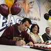 Broomfield High's Cole Chapleski signs his letter of intent to the University of Denver on national signing day in the Eagle Gym on Wednesday.<br /> February 3, 2010<br /> Staff photo/David R. Jennings