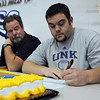 Broomfield High's Cody Wheeler signs his letter of intent to University of Nebraska, Kearny while his father Todd watches on national signing day in the Eagle Gym on Wednesday.<br /> February 3, 2010<br /> Staff photo/David R. Jennings