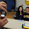 Jodee Seitz, left, takes a picture of her son Garrett with his friend Jiana Davis during Broomfield High national signing day in the Eagle Gym on Wednesday.<br /> February 3, 2010<br /> Staff photo/David R. Jennings