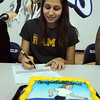 Broomfield High's Kayla Wein signs her letter of intent to Colorado State University on national signing day in the Eagle Gym on Wednesday.<br /> February 3, 2010<br /> Staff photo/David R. Jennings
