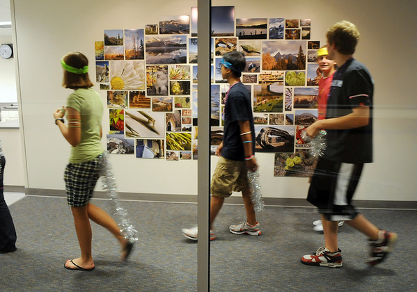 Freshman walk past the photo display in the new photgraphy lab while touring Broomfield High School on Tuesday. <br /> August 18, 2009<br /> staff photo/David R. Jennings
