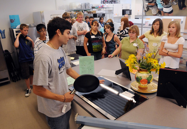 Leader Elias Elias, left, shows his group the new kitchen for the Pro Start classes while touring the school during Freshman Orientation Day at Broomfield High School on Tuesday.<br /> <br /> August 18, 2009<br /> staff photo/David R. Jennings